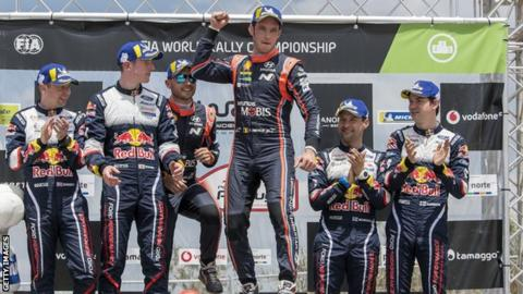 Elfyn Evans (second from left) and co-driver Daniel Barritt finished 40 seconds behind Rally Portugal winner Thierry Neuville (centre)