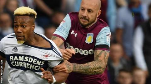 Alan Hutton tangled with ex-Villa team-mate Adama Traore in the play-off semi-final win aggregate victory over Middlesbrough
