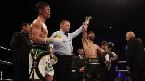 Linares is announced as winner as Anthony Crolla looks on