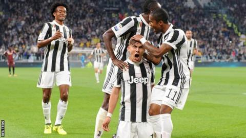 Paulo Dybala celebrates scoring against Torino for Juventus