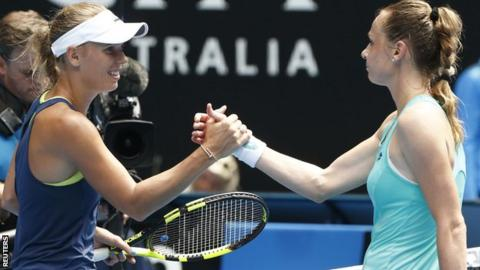 Caroline Wozniacki and Magdalena Rybarikova shake hands