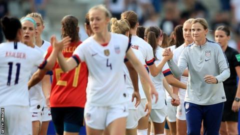 Jill Ellis (right) congratulates her players