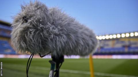 A microphone in a football stadium