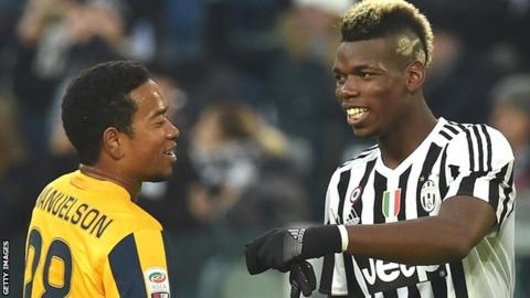 Urby Emanuelson (left) playing for Verona against Paul Pogba of Juventus