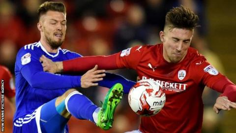 Cardiff's Anthony Pilkington in action against Barnsley's Angus MacDonald