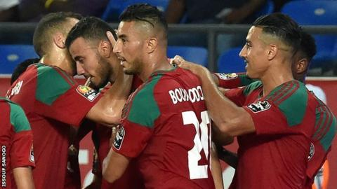 Morocco celebrate during their victory over Togo