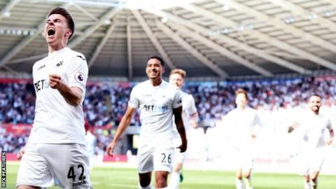 Tom Carroll celebrates goal