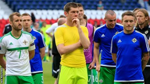 Michael McGovern (centre) is left disappointed as Northern Ireland exit Euro 2016