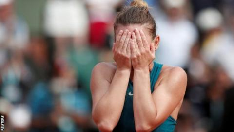 Simona Halep covers her eyes after sealing victory