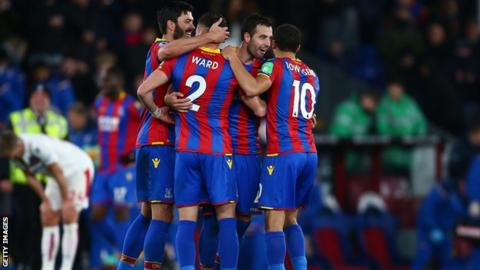 Crystal Palace players celebrate at the end.