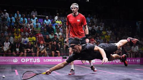 Zac Millar of New Zealand competes in a mixed doubles squash match against England on day six of the Gold Coast 2018 Commonwealth Games at Oxenford Studios