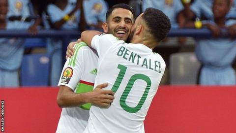 Riyad Mahrez is congratulated by Nabil Bentaleb