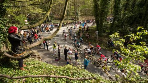 Cyclists competing in the second stage of the Men's Tour de Yorkshire ascend Blacker Hill near Barnsley