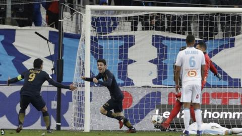 Monaco's players celebrate scoring against Marseille