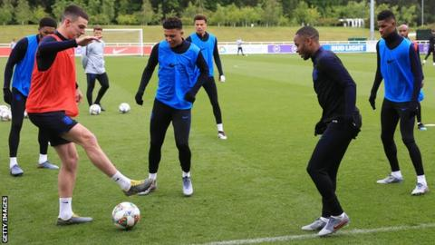 Raheem Sterling trains with England