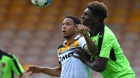 Nathan Tyson holds of Kortney Hause of Wolverhampton Wanderers while on trial with Port Vale