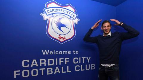 Emiliano Sala doing the Ayatollah in front of the Cardiff City logo
