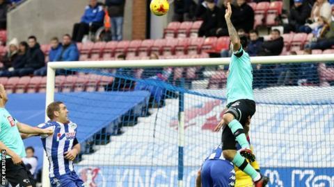 Bradley Johnson heads in