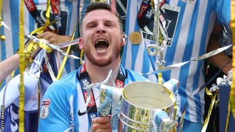 Chris Stokes celebrates after helping Coventry City get promoted