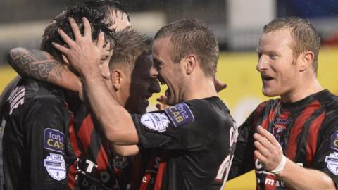 Richard Clarke congratulates Jordan Forsythe after his goal helps Crusaders to a 3-0 win over the Glens