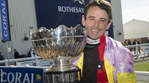 Winning jockey Sean Quinlan with the Scottish Grand National trophy