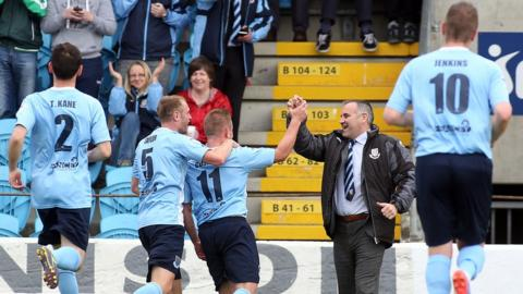 David Cushley runs to celebrate with Ballymena manager Glenn Ferguson after finding the net in a 6-1 win over Cliftonville