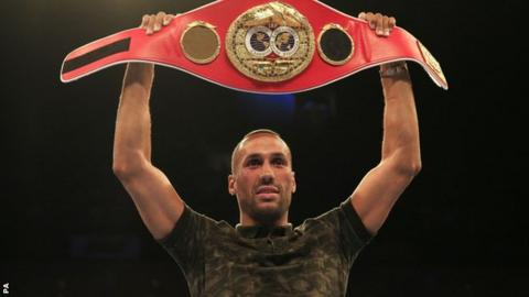 James DeGale holds aloft his belt