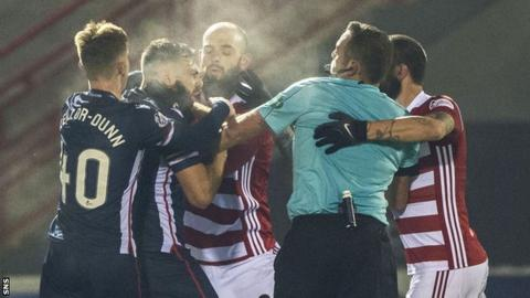 Referee Gavin Duncan tries to separate Hamilton and Ross County p;layers
