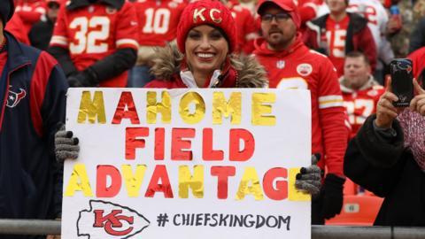 A Kansas City Chiefs fan holds a sign
