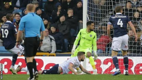 Mark Beevers heads in Bolton's opener at Millwall.