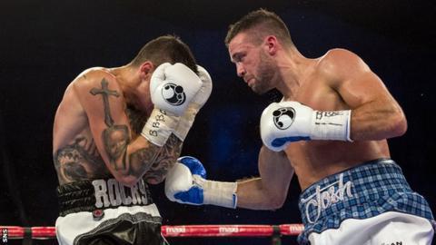 Josh Taylor lands a body punch on Dave Ryan