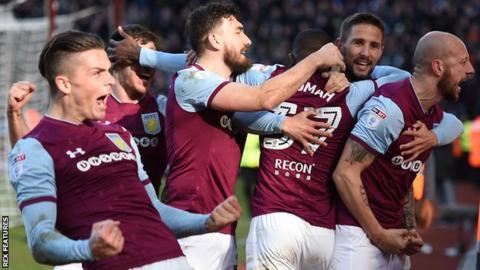 Aston Villa celebrate Albert Adomah's goal