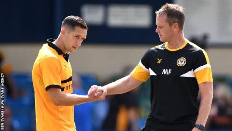 Newport captain Andrew Crofts (L) and manager Mike Flynn