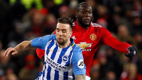 Manchester United's Romelu Lukaku in action with Brighton's Shane Duffy