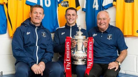 Dunston UTS boss Chris Swailes pictured with chairman Malcolm James and player Dan Halliday, who is holding the FA Cup