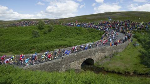 Spectators watch the Tour de France in the Yorkshire Dales in 2014