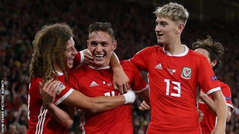Connor Roberts (centre) celebrates his first goal for Wales in the win over the Republic of Ireland