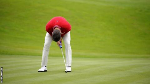 A golfer looks distraught