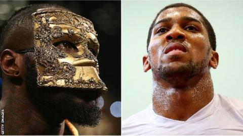Wilder (left) said he was glad drawn out negotiations with Joshua were now seemingly over
