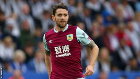 Burnley winger Robbie Brady playing in a match
