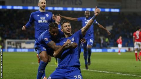 Marko Grujic celebrates scoring a goal with Kadeem Harris of Cardiff City in their 2-1 win over Barnsley.