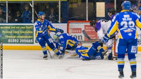 Fife Flyers' Shane Owen makes a save from Jay Rosehill of Braehead Clan in Monday's meeting in Kirkcaldy