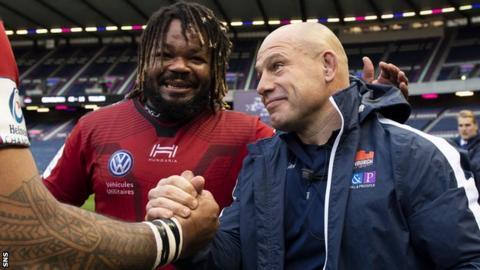 Richard Cockerill is congratulated by Toulon captain Mathieu Bastareaud after Edinburgh's pool win at Murrayfield