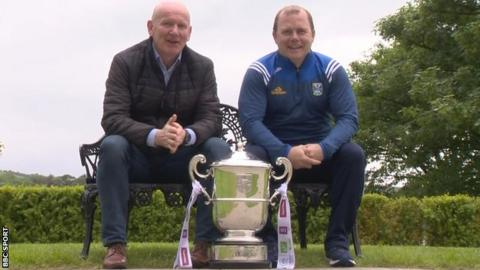 Donegal boss Declan Bonner and Cavan manager Mickey Graham with the Anglo-Celt trophy