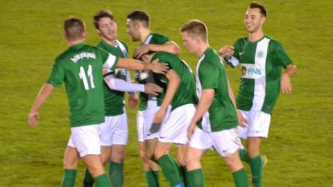 Charlie Laine is congratulated by his team-mates after scoring the opener