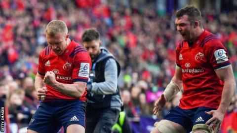 Winger Keith Earls (left) celebrates his winning try alongside Munster captain Peter O'Mahony