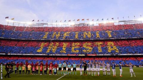 A mosaic message reading 'Forever Iniesta' formed by the Barcelona fans