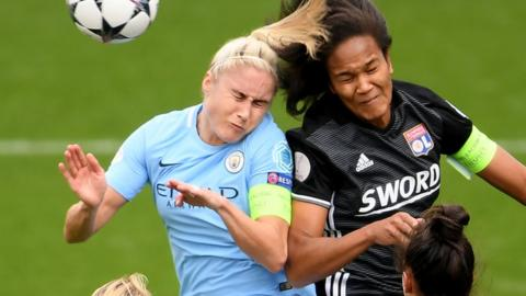 Steph Houghton and Wendie Renard challenge for a header