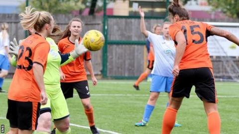 Lidija Kulis (right) heads home one of her two goals for Glasgow City against Renfrew