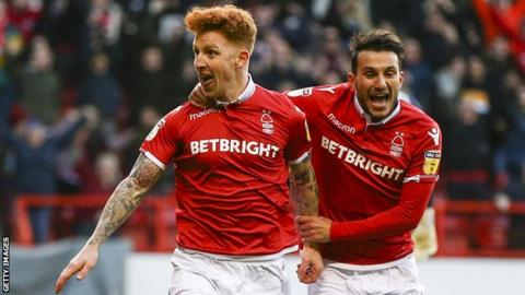 Nottingham Forest players Jack Colback and Joao Carvalho celebrate a goal against Leeds United